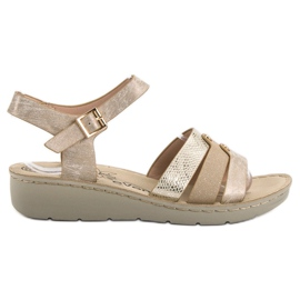 Evento gul Gyllene sandaler