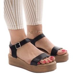 Svarta sandaler på plattformen 22-07