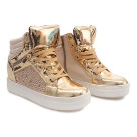 Isolerade sneakers Y-25 guld