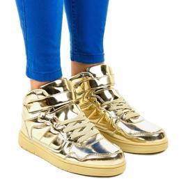 Guldlackerade sneakers XW7082