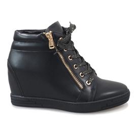 Svarta sneakers med guldreglage för TL-22