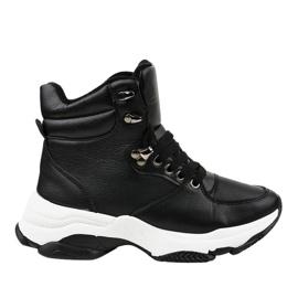 Svarta kvinnors isolerade sneakers C-3132