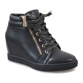Svarta sneakers med guldreglage för TL-22 1