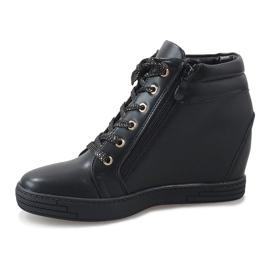 Svarta sneakers med guldreglage för TL-22 2