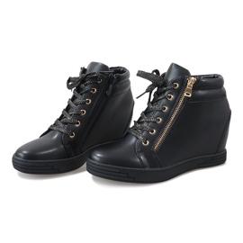 Svarta sneakers med guldreglage för TL-22 3