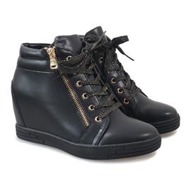 Svarta sneakers med guldreglage för TL-22 4