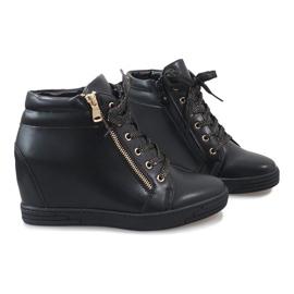 Svarta sneakers med guldreglage för TL-22 5